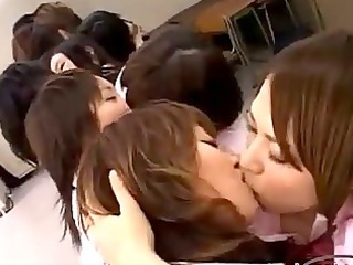 schoolgirls giving a kiss licking and fingering