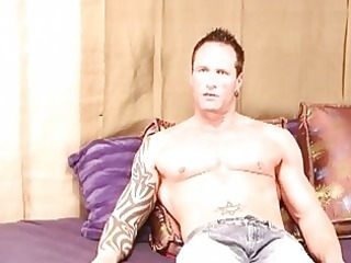 powerful tattooed homosexual hunk jerks off his