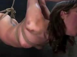 skinny cutie hanging fastened to pole