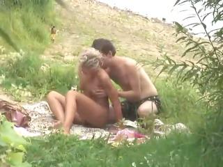 voyeuring on a pair having outdoor sex