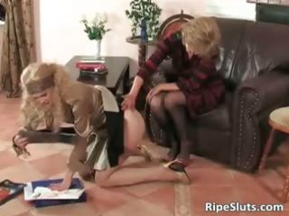 breasty older wench puts belt on sextoy