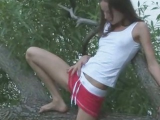 brunette hair russian playing in a forest
