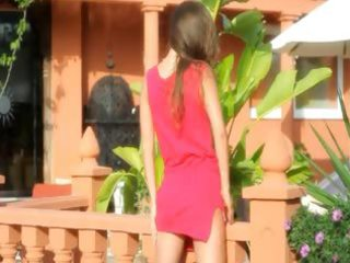 nice-looking sweetheart in red stripping outdoors
