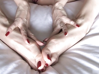 juvenile woman plays with her feet.