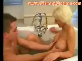 blond aged mommy drilled in the baths