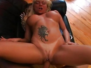 enormous chested blond with tattoo and pierced