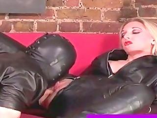 leather wearing female-dominator sucks her serf
