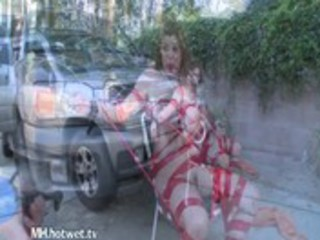 a infirm housewife getting hosed on the driveway
