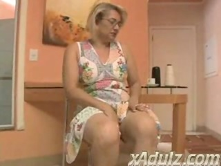 corpulent blond granny doing crochet acquires