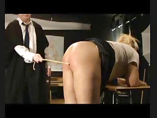 sadomasochism caning - eight strokes over nude