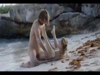extraordinary art sex of sleek pair on beach