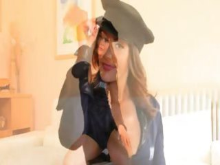 policewoman pose on the white bed