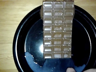 large spunk fountain (44 spurts) onto a chocolate