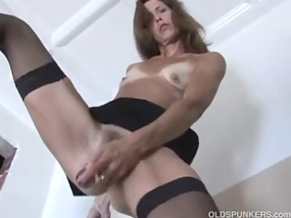 agreeable mature red head in stockings