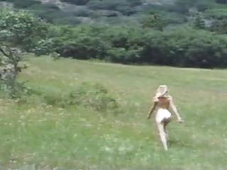 blond dances around outdoor