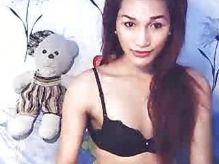 ladyboy undresses and masturbates