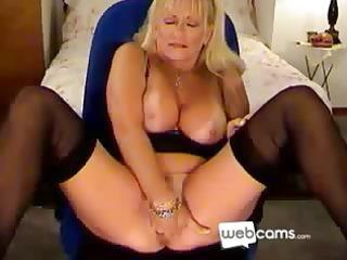 sexy golden-haired cougar masturbates on her