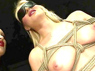 female-dominator playing with slavegirl