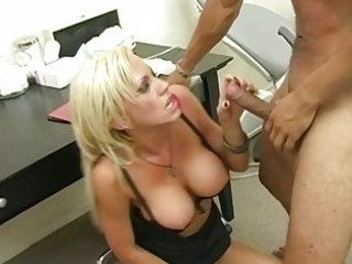 pretty blond with large whoppers engulfing rod