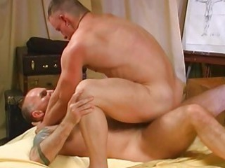 muscled homosexual men having doggy style sex in