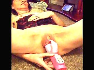 old granny masturbates with toy