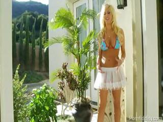 breasty blond floozy presents her astounding body