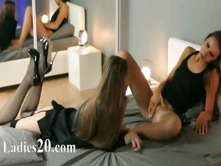 youthful beauties in good suit engulfing toy